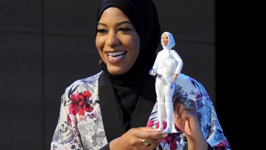 Olympic fencer Ibtihaj Muhammad shows the hijab-wearing Barbie modeled after her. (Twitter photo: Ibtihaj Muhammad @IbtihajMuhammad)