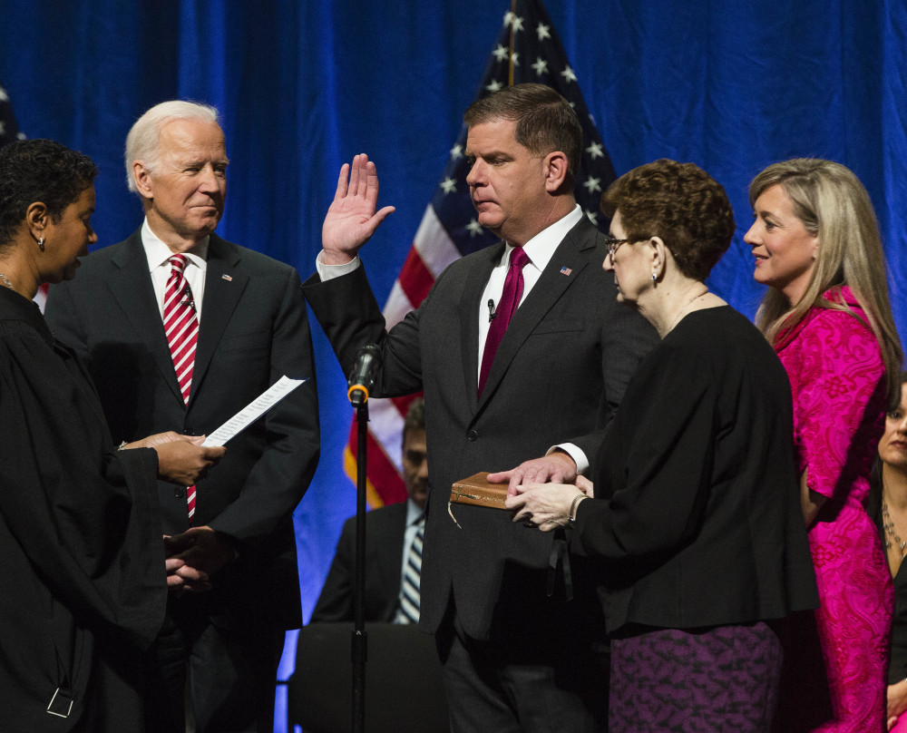 "Former Vice President Joe Biden watches as Mayor Marty Walsh is inaugurated at the Cutler Majestic Theatre in Boston on Monday. ""We are one of the greatest cities in the world and after nearly four centuries, our greatest days are yet to come,"" Walsh said."
