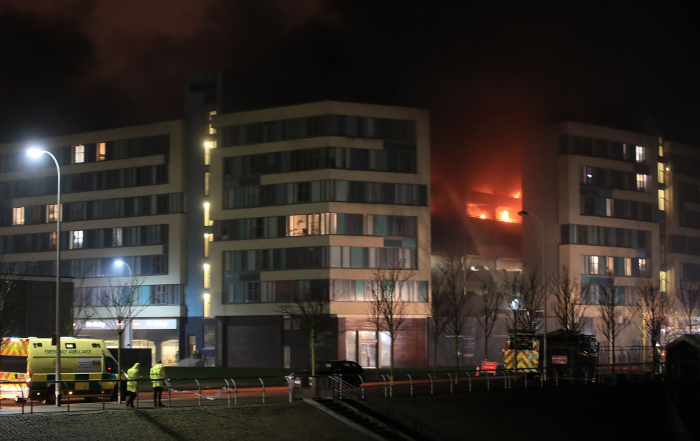 Emergency services respond to a fire at a multistory car park on Liverpool's waterfront in northwest England on Sunday.