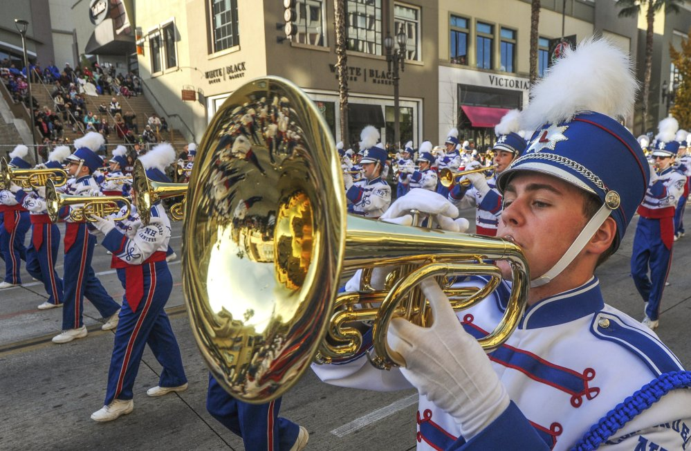 Members of the Londonderry High School Marching Lancers, from New Hampshire, perform in the 2018 Tournament of Roses Parade in Pasadena, Calif., on Monday.