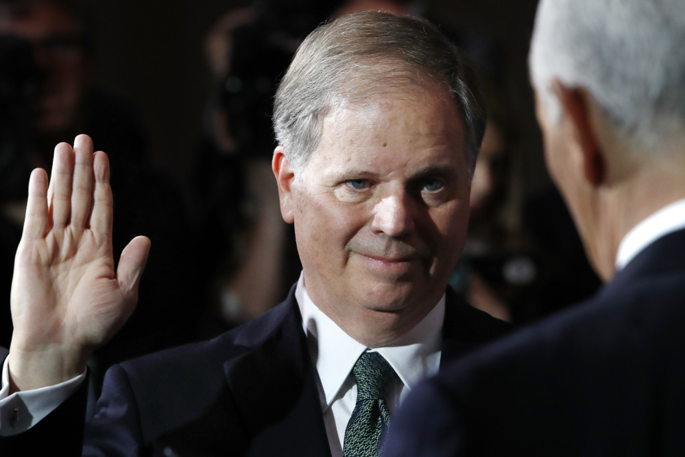 Sen. Doug Jones, D-Ala., listens as Vice President Mike Pence, right, administers the Senate oath of office during a mock swearing-in ceremony in the Old Senate Chamber on Capitol Hill in Washington.