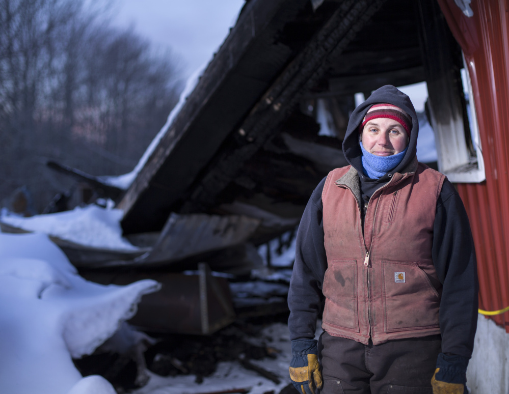 Heather Donahue of Balfour Farm in Pittsfield stands next to a structure that housed a commercial kitchen that was destroyed in a fire several weeks ago.