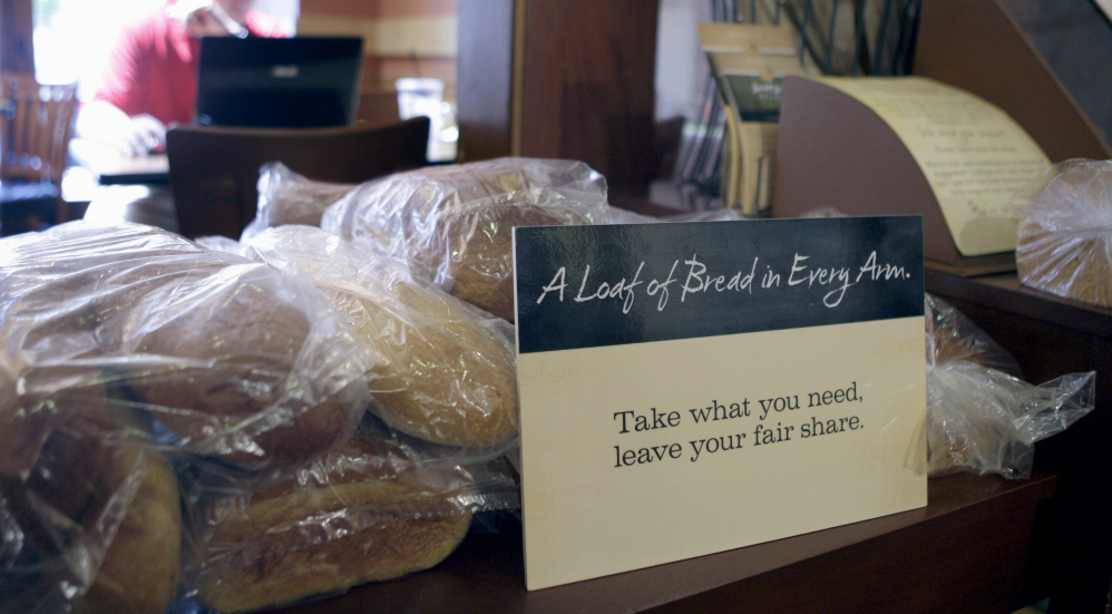 Loaves of bread sit on a table at St. Louis Bread Co. Cares Community Cafe, part of Panera, in Clayton, Mo.