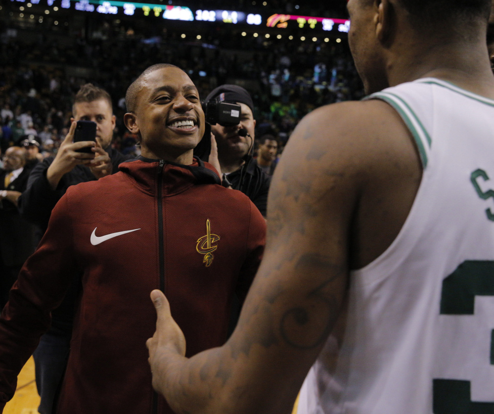 The jacket colors were different but that smile, the one that captivated a city the past two years, was still on Isaiah Thomas' face Wednesday night as he returned to Boston, this time with the Cleveland Cavaliers, and saw old teammates such as Marcus Smart.