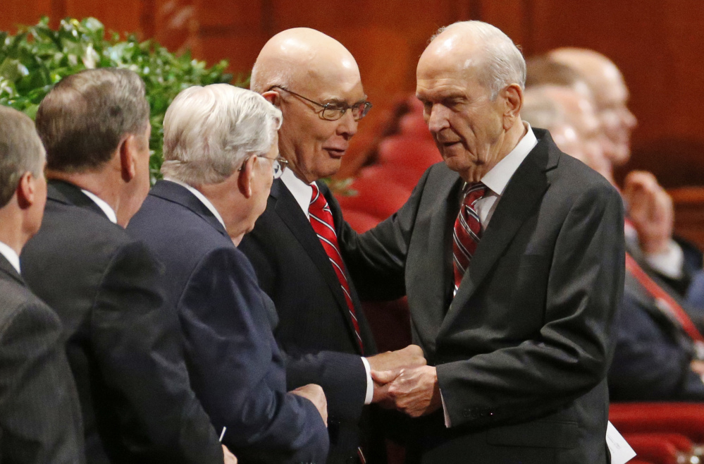 Russell M. Nelson, right, president of the Quorum of the Twelve Apostles greets members of the leadership during a Mormon conference in Salt Lake City last fall. Nelson is set to be named the new president of The Church of Jesus Christ of Latter-day Saints. Nelson, a doctrine conservative, isn't likely to push for changing the church's opposition to gays.