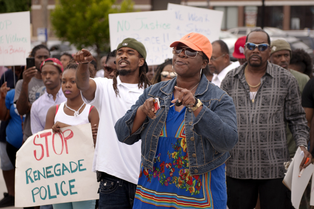 Demonstrators rally in 2014 to protest the shooting of Michael Brown, 18, by police in Ferguson, Mo. The shooting prompted national scrutiny of shootings by police and led many law enforcement agencies to examine their use of deadly force. But the numbers for 2017 show no decrease in the number of people killed by police.
