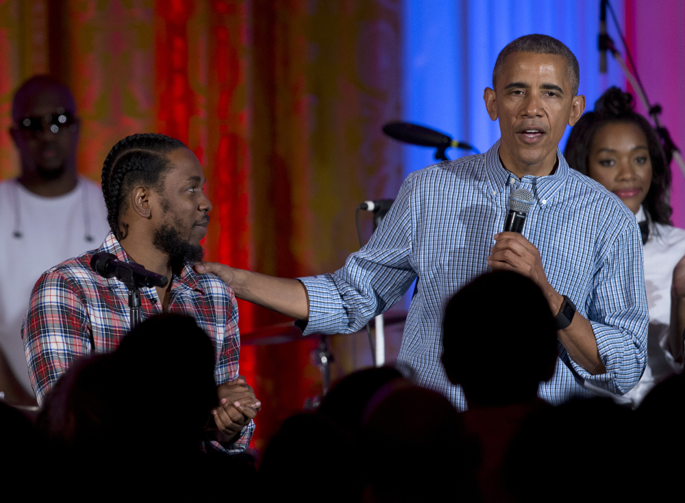 President Obama, joined by Kendrick Lamar, speaks during an Independence Day celebration for members of the military and their families, at the White House, in Washington in 2016.