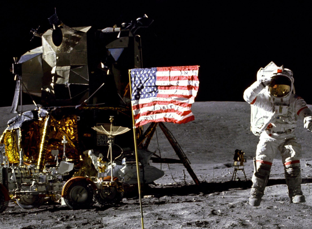 John Young salutes the flag at the Descartes landing site on the moon during the first Apollo 16 extravehicular activity in 1972.