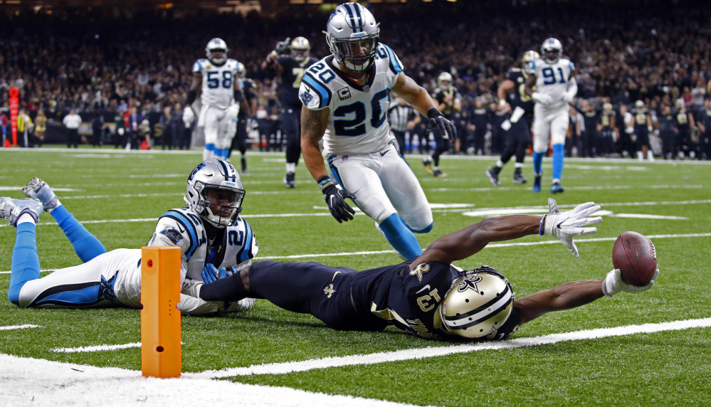 Saints receiver Michael Thomas reaches over the goal line after being tackled short of the end zone by Carolina's James Bradberry during the Saints' 31-26 playoff win Sunday.