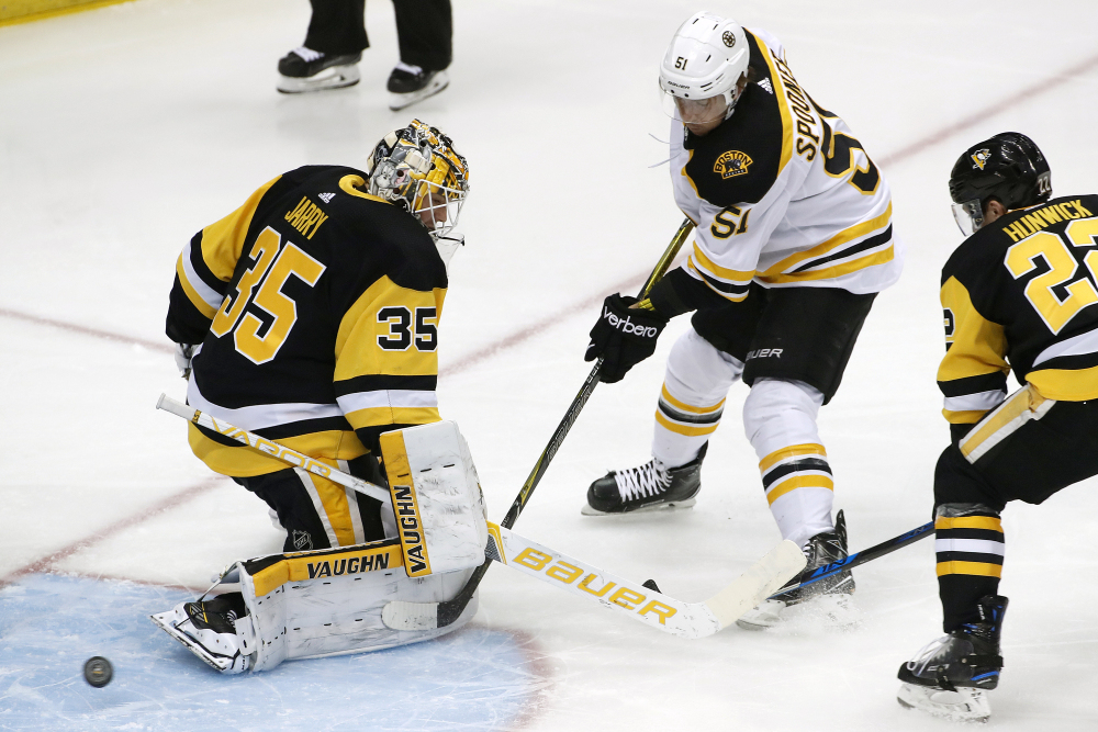 Boston Bruins' Ryan Spooner gets a shot past Pittsburgh Penguins goaltender Tristan Jarry for a goal with Matt Hunwick defending in the first period of Sunday's NHL game in Pittsburgh. Associated Press/Gene J. Puskar
