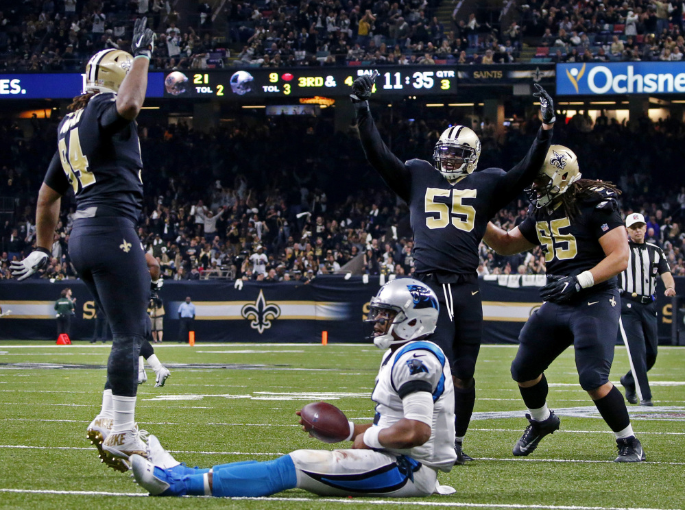 Saints linebacker Jonathan Freeny, 55, celebrates his sack of Panthers quarterback Cam Newton on Sunday. Carolina will be reviewed for the handling on Newton's injury.