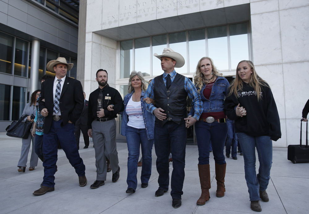 "From left, Ammon Bundy, Ryan Payne, Jeanette Finicum, widow of Robert ""LaVoy"" Finicum, Ryan Bundy, Angela Bundy, wife of Ryan Bundy, and Jamie Bundy, daughter of Ryan Bundy, walk out of a federal courthouse in Las Vegas."