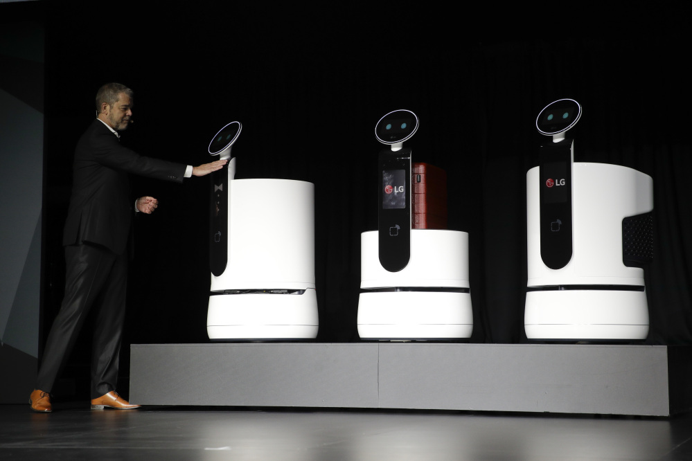 LG's David Vander Waal introduces the new-concept robots during a news conference at CES International Monday. (AP Photo/Jae C. Hong)
