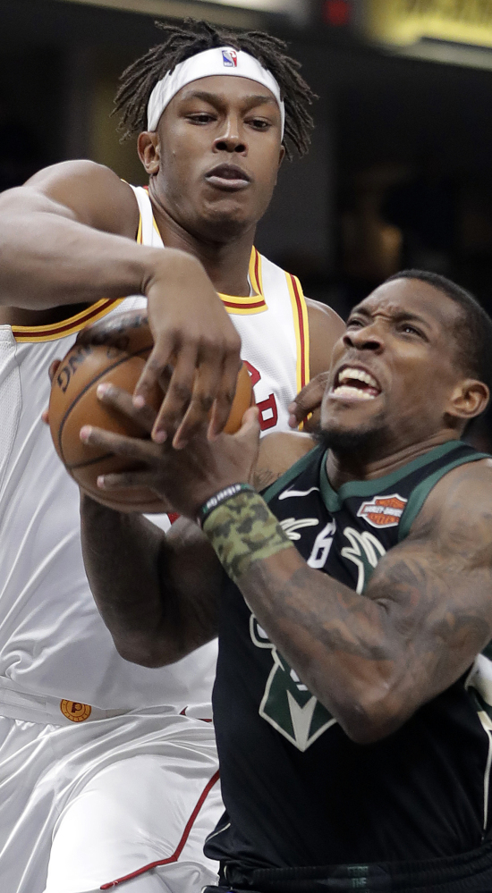 Milwaukee's Eric Bledsoe, right, goes to the basket against Indiana's Myles Turner during the Pacers' 109-96 win Monday.