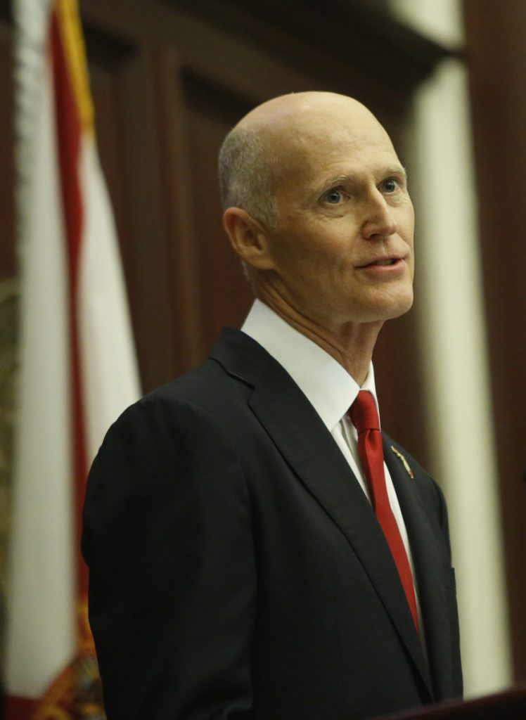 "Gov. Rick Scott said of the administration's change: ""It's a good day for Florida"""