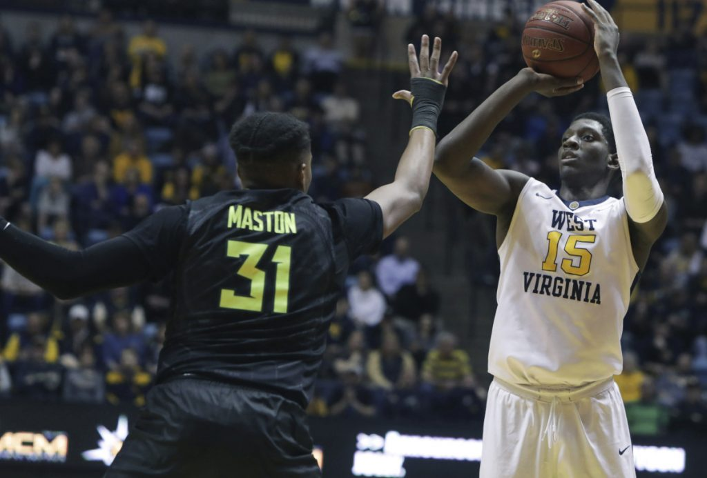 Lamont West of West Virginia shoots while being defended by Terry Maston of Baylor during the second half of West Virginia's 57-54 victory Tuesday night. The Mountaineers have the nation's longest winning streak at 15.