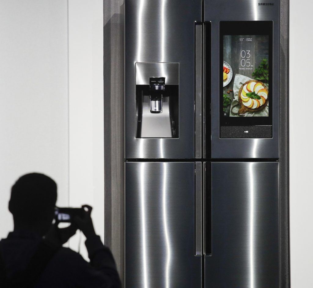 The 2018 model of the Samsung Family Hub smart refrigerator, which syncs up food storage with meal preparation and expands voice control by the personal assistant Bixby, is displayed at the CES gadget show in Las Vegas.