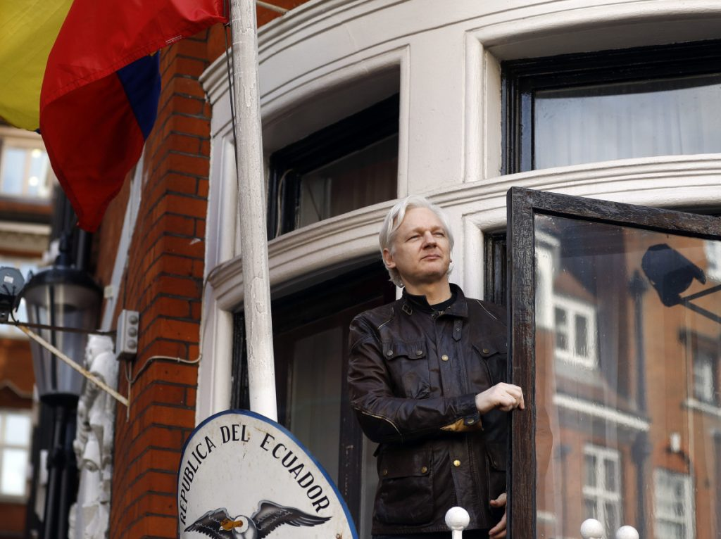 FILE- In this  2017 file photo, WikiLeaks founder Julian Assange greets supporters outside the Ecuadorian embassy in London.