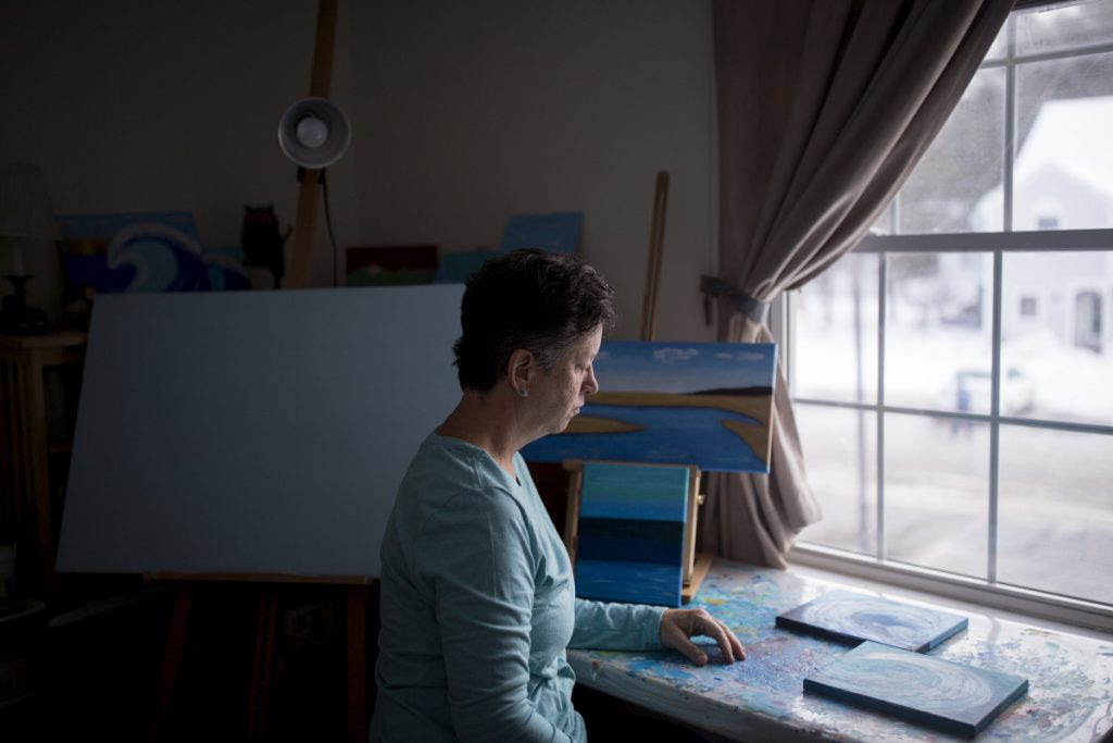 Judy Bullard, a painter who lives in Old Orchard Beach and receives Medicaid benefits, has epilepsy and says the condition prevents her from working regularly.