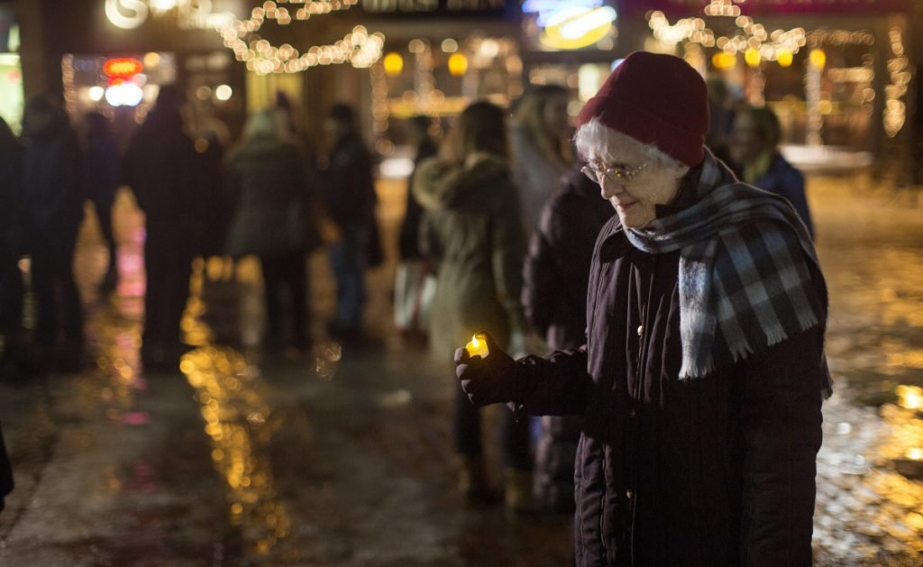 Sister Lucille Gardner holds a candle during a vigil Thursday in support of National Human Trafficking Awareness Day in Monument Square. Hope Rising, which held the vigil, is a residential treatment program in Penobscot County that serves victims of human trafficking.