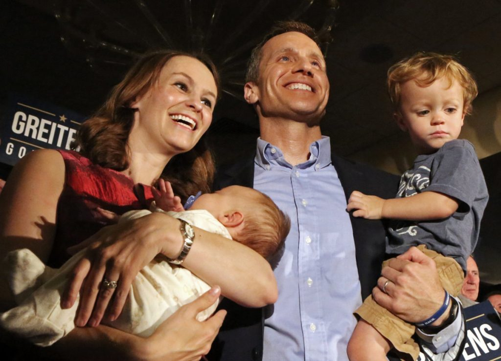Eric Greitens, a rising star in the Republican Party, celebrates winning the primary election with his wife, Sheena, and his two sons, Jacob and Joshua, in 2016.