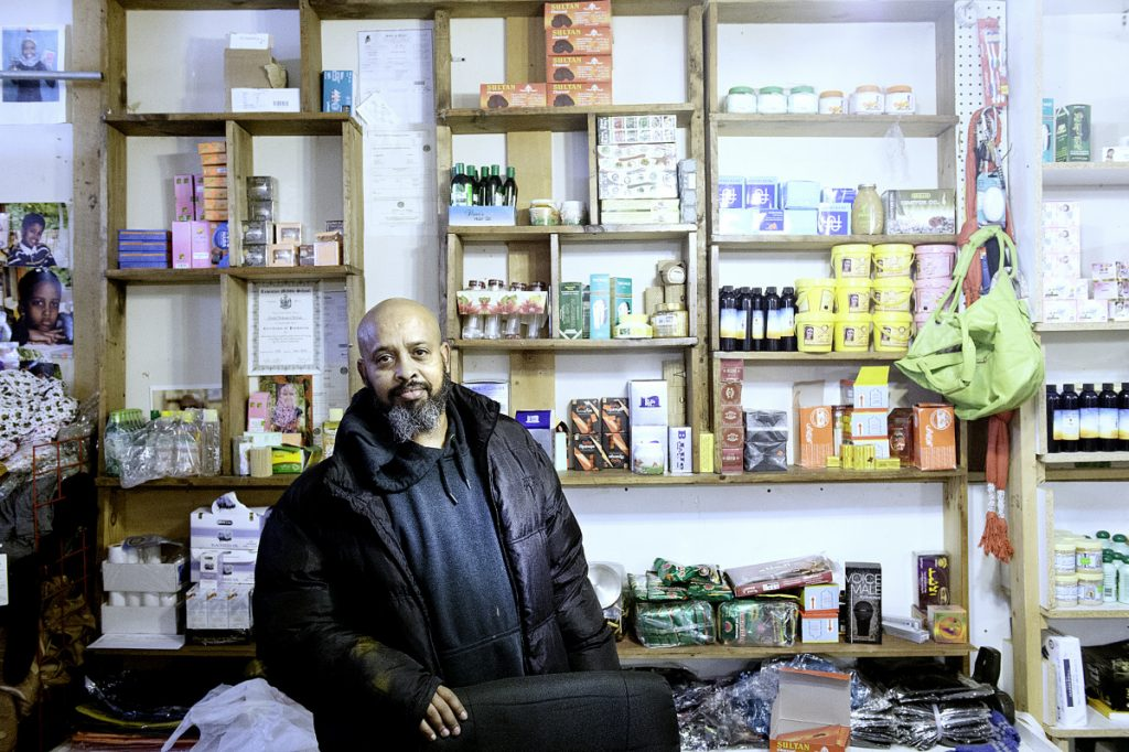 """Mohamed Heban moved to Lewiston in 2002 from Atlanta. He and his wife have raised five children in Lewiston and own the Baraka Store on Lisbon Street. """"It's great,"""" Heban said of living in the city. """"The majority of people are good, friendly neighbors."""""""