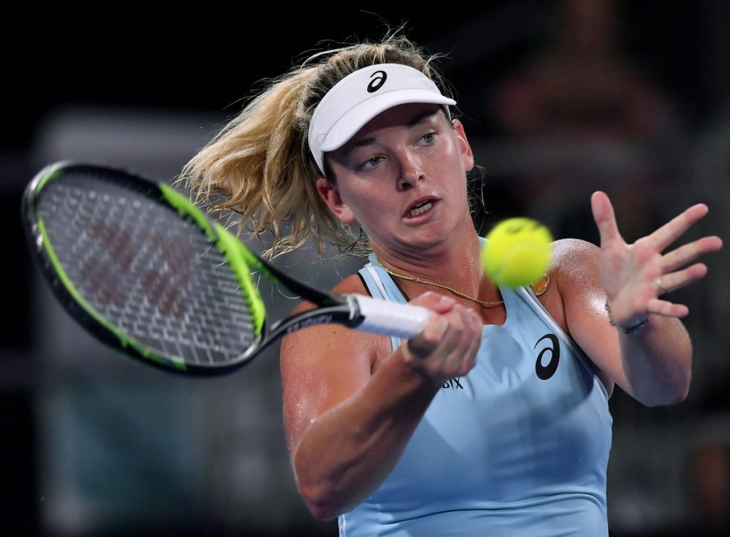 CoCo Vandeweghe of the United States hits a forehand return to Hungary's Timea Babos during their first-round match at the Australian Open in Melbourne, Australia.