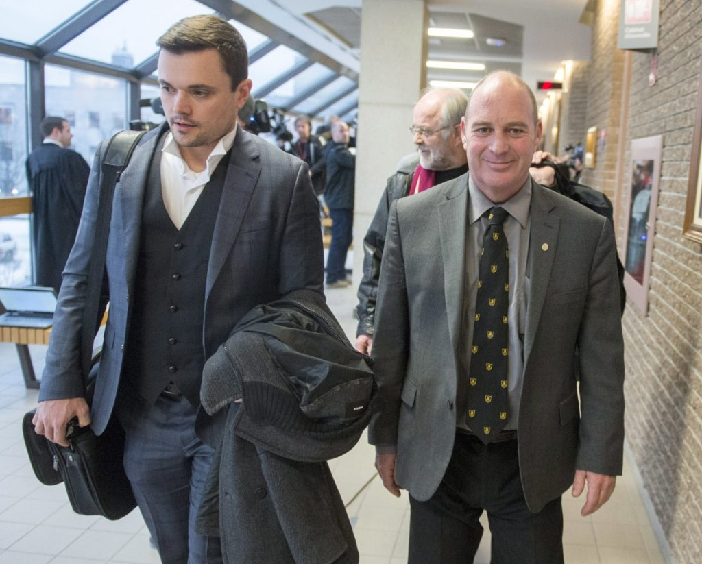 Train driver Thomas Harding leaves the courtroom with his lawyers Charles Shearson, left, and Tom Walsh, rear, after being found not guilty on the ninth day of deliberations Friday in Sherbrooke, Quebec. One of the most closely watched Canadian trials in recent years ended Friday with the acquittal of three former railway employees who were charged with criminal negligence in the death of 47 people in the Lac-Megantic tragedy.