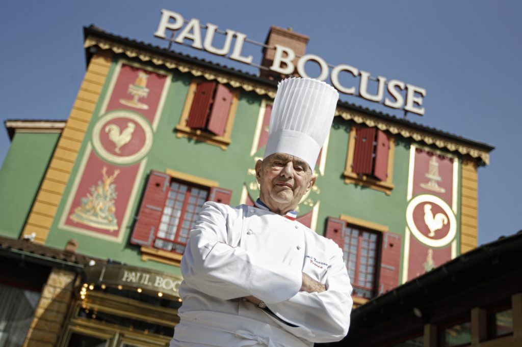 Paul Bocuse poses outside his famed Michelin three-star restaurant L'Auberge du Pont de Collonges in Collonges-au-Mont-d'or, central France.