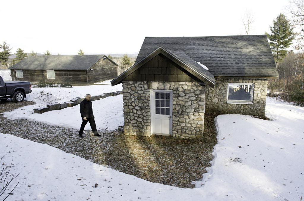 Summit Spring President Bryan Pullen walks into the Harrison spring house that was built in 1936. (Daryn Slover/Sun Journal)