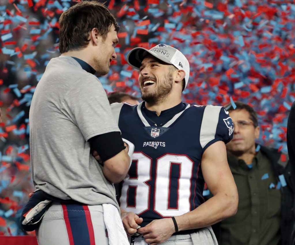 Patriots quarterback Tom Brady, left, speaks to wide receiver Danny Amendola after the game.