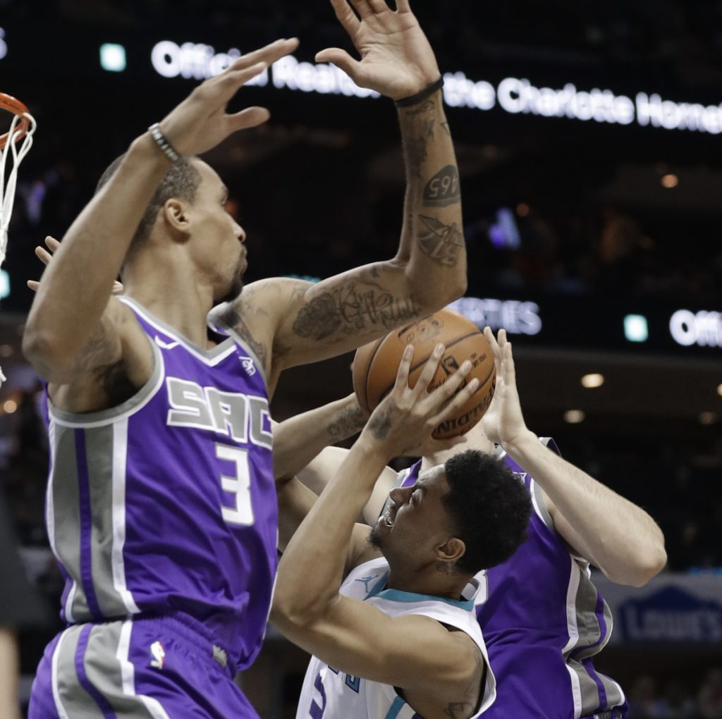 Charlotte's Jeremy Lamb, center, tries to get off a shot between Sacramento's George Hill, left, and Kosta Koufos during the Hornets' 112-107 win Monday in Charlotte, N.C.