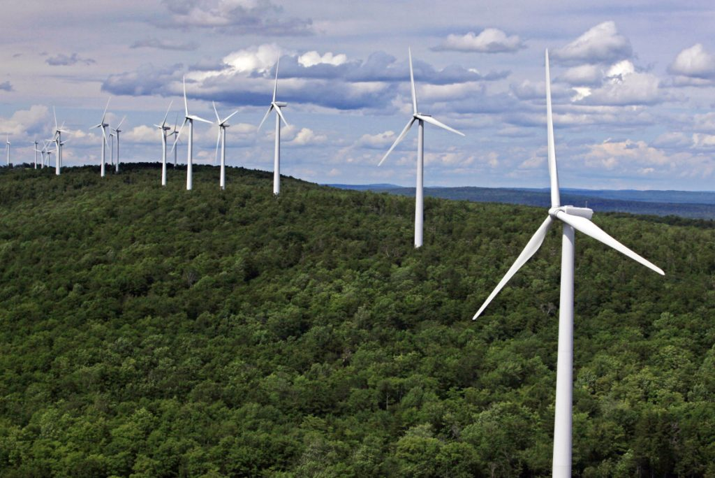 Wind turbines line a ridge in Township 8, Range 3 in Maine. Critics of the governor's newly imposed wind-power moratorium said it