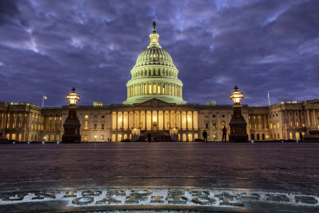 The U.S. Capitol Building is lit up as night falls in Washington.  President Trump will deliver his first State of the Union address Tuesday night.