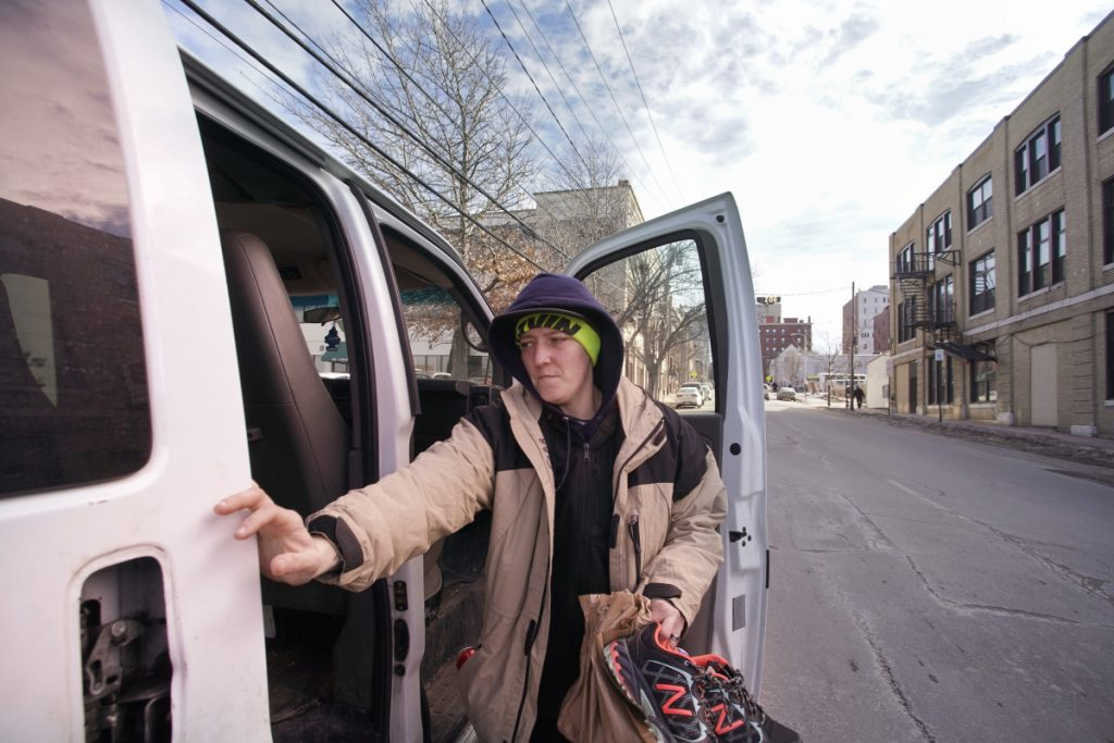 Trish Farr opens the door to a van at Complete Labor in Portland that brings her and her wife, Katie, to a job in Biddeford. The two women started working for Portland Opportunity Crew.