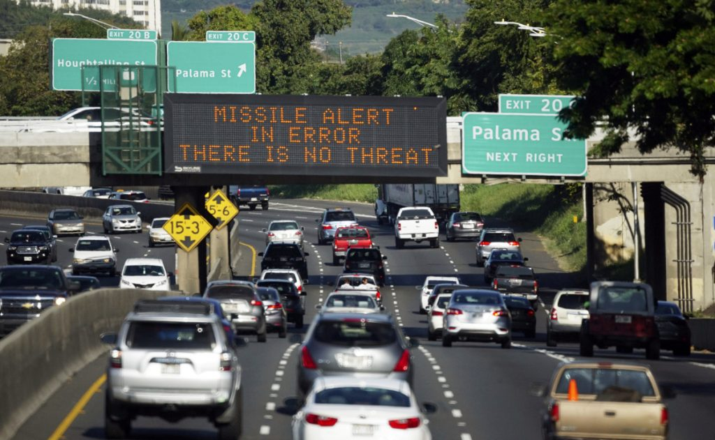 "Cars drive past a highway sign that says ""MISSILE ALERT ERROR THERE IS NO THREAT"" on the H-1 Freeway in Honolulu, Hawaii, on Jan. 13. A Hawaii employee mistakenly sent an alert warning of an incoming ballistic missile."