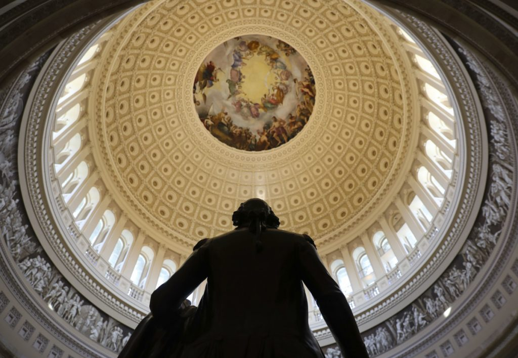 The Capitol Rotunda is seen with the statue of George Washington.