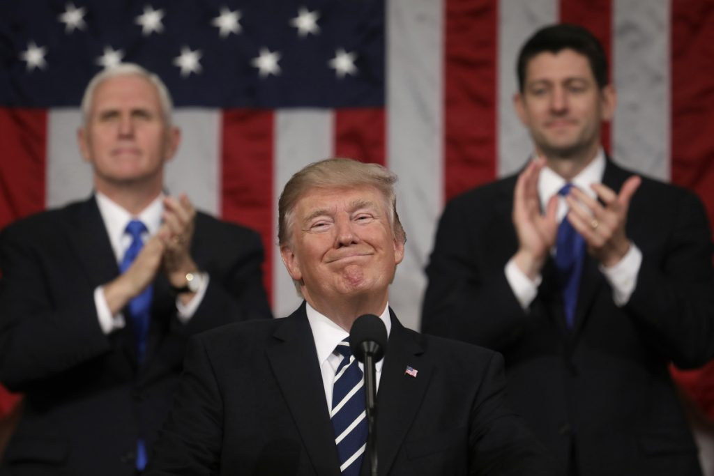President Donald Trump. In the background are Vice President Mike Pence and House Speaker Paul Ryan of Wisconsin.