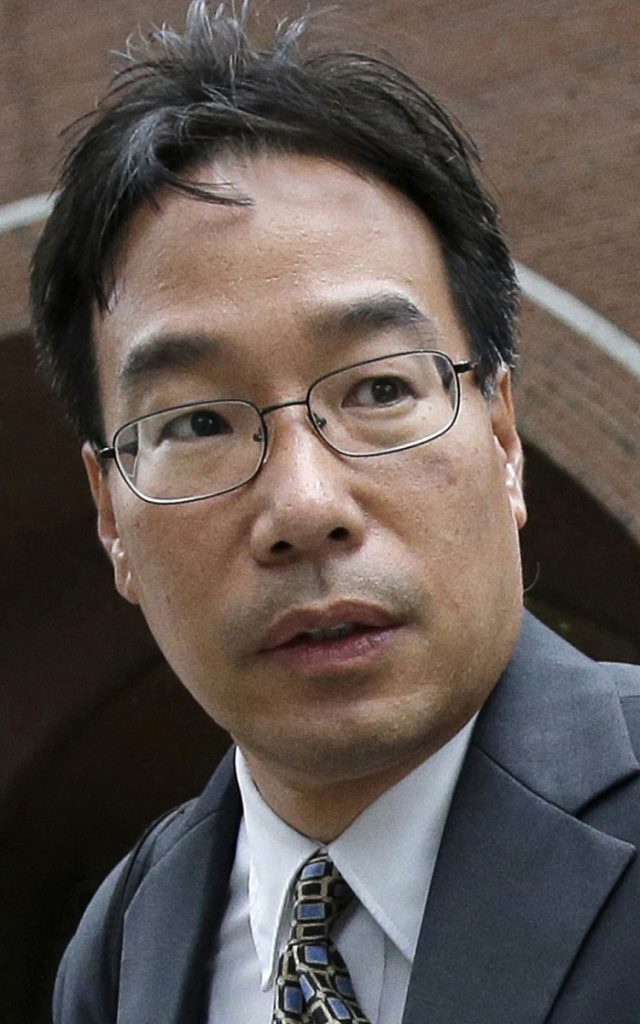 FILE - In this Sept. 19, 2017, file photo, Glenn Chin, supervisory pharmacist at the now-closed New England Compounding Center, leaves federal court in Boston. Chin, a Massachusetts pharmacist charged in a deadly 2012 meningitis outbreak, was cleared in October of second-degree murder charges, but convicted on dozens of other counts. He is scheduled to be sentenced on Wednesday, Jan. 31, 2018. (AP Photo/Steven Senne, file)
