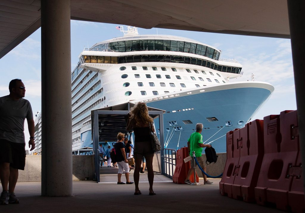 Passengers walk near Anthem of the Seas, the largest cruise ship to visit Portland in 2016. The majority of cruise ship visits to Maine occur in September and October, when many tourists want to see fall foliage.