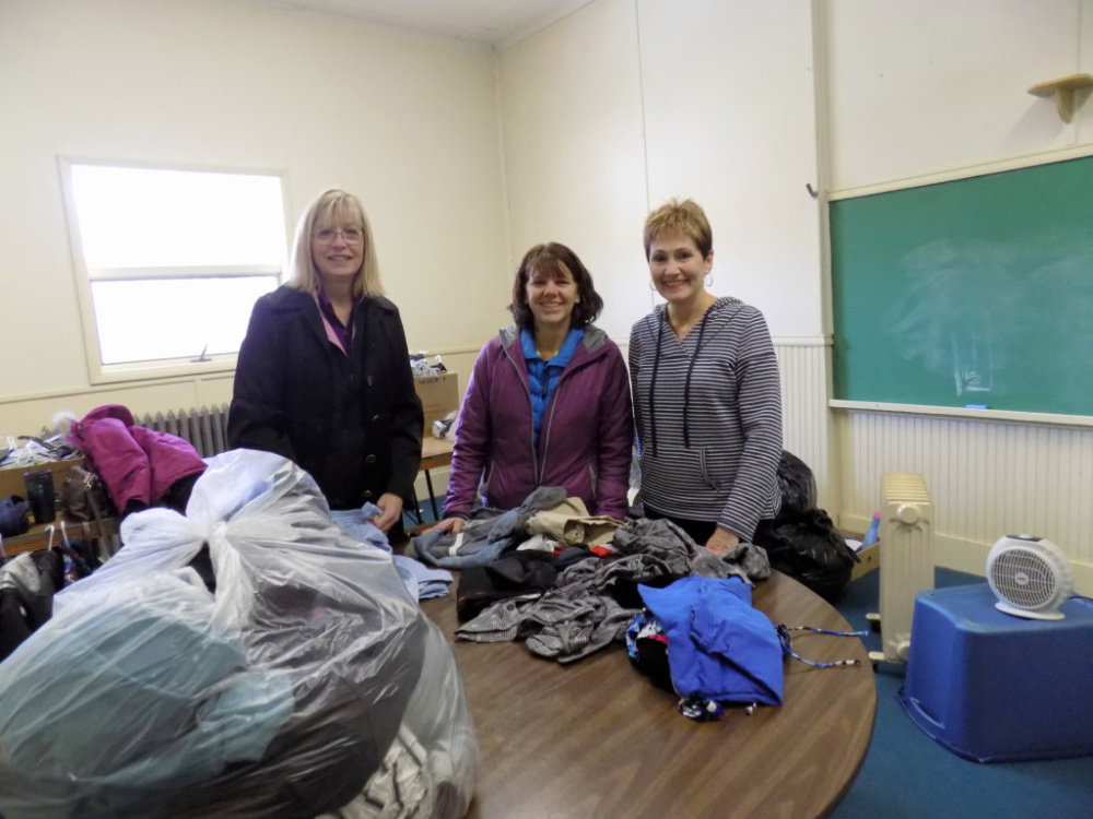 The Free Store, housed on the third floor of the St. Rose of Lima Parish Hall in Jay, is overseen by, from left, Julie Taylor, Tammy Deering and Nancy Anctil.