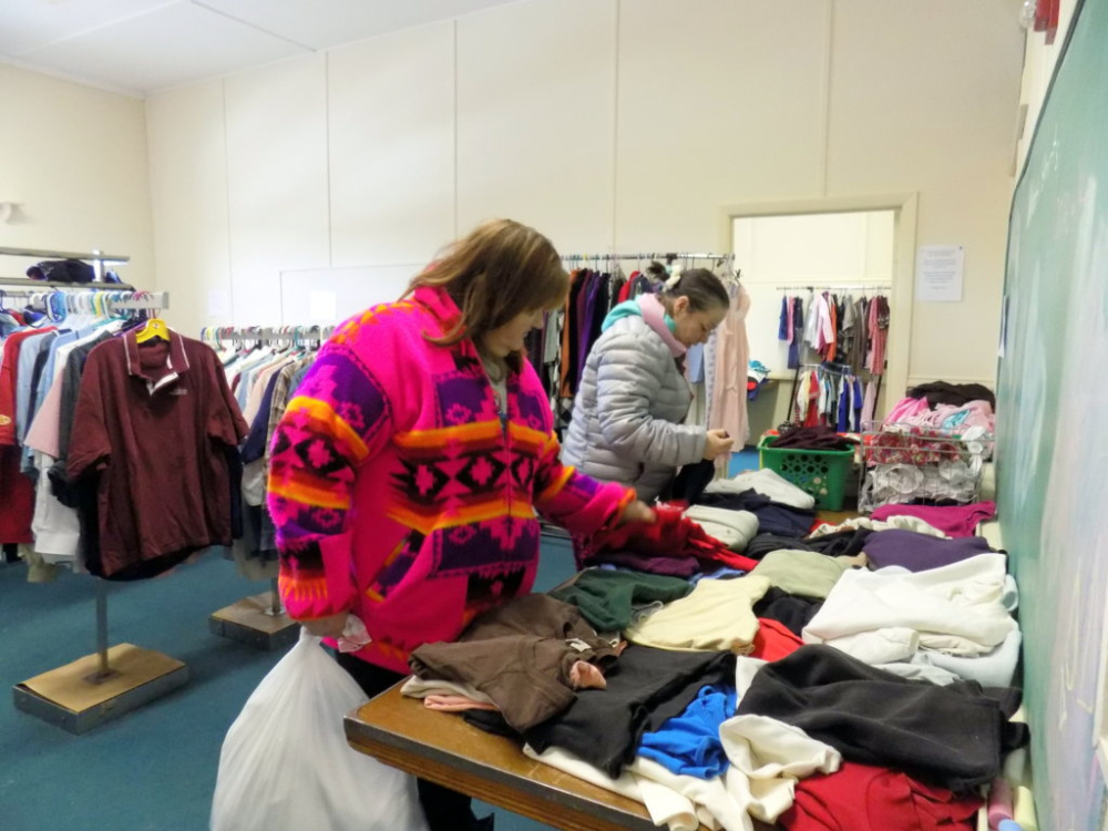 Anna Crockett and Amber LeBlanc shop at The Free Store in Jay recently. Housed on the third floor of the St. Rose of Lima Parish Hall, the store provides free clothing, accessories and small household items. It is open most Saturdays from 9 a.m. to noon.