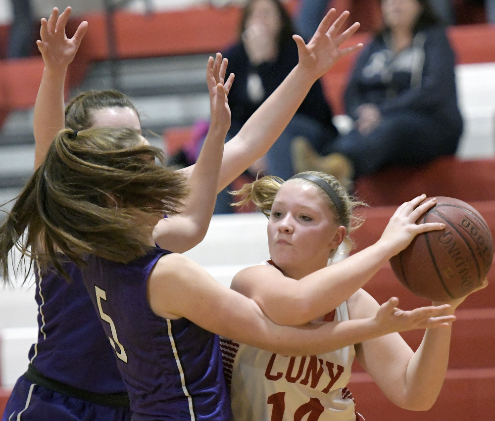 Cony junior Brooklyn Belanger looks for an opening as Waterville defenders converge during a Kennebec Valley Athletic Conference game Tuesday in Augusta.