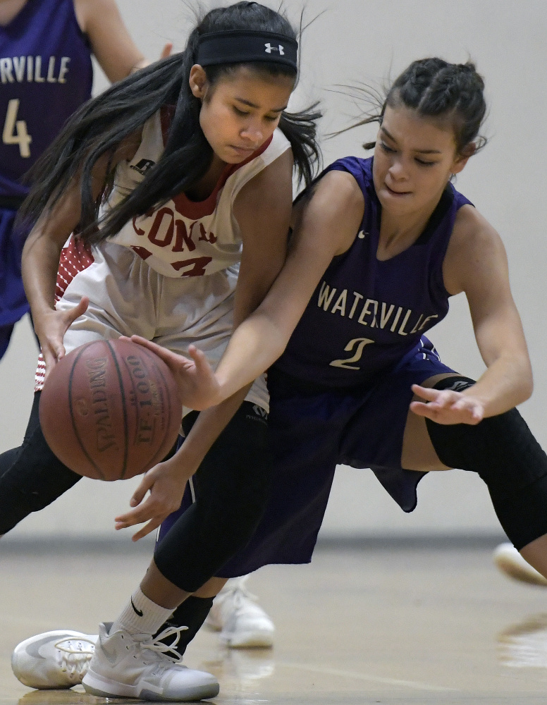 Cony sophomore Linelys Velazquez, left, is blocked by Waterville defender Paige St. Pierre during a Kennebec Valley Athletic Conference game Tuesday in Augusta.