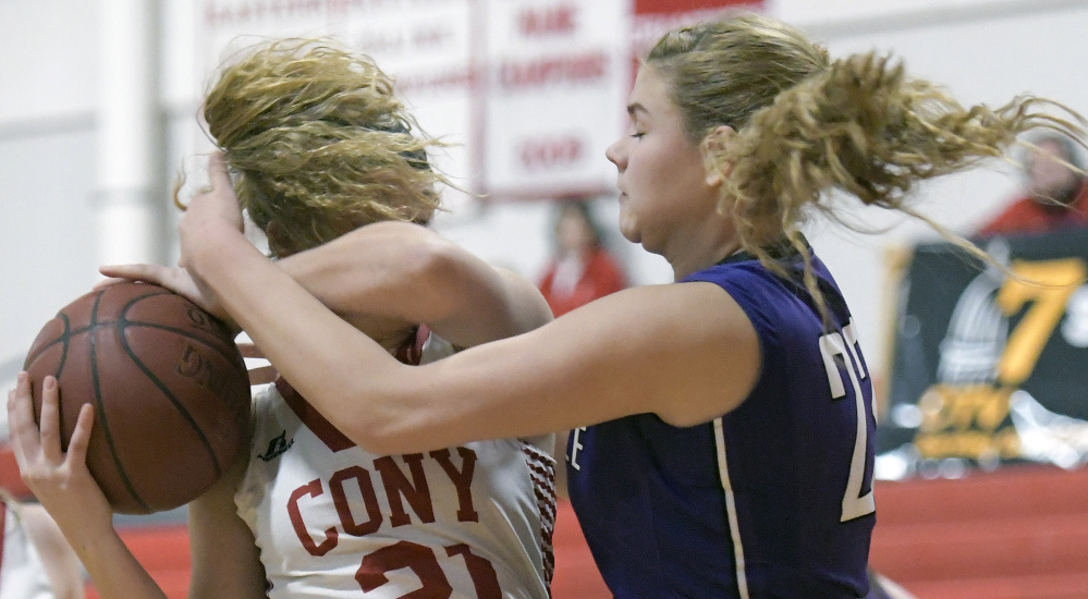 Cony junior Peyton Miller, left, is defended by Waterville's Maddie Martinduring a Kennebec Valley Athletic Conference game Tuesday in Augusta.