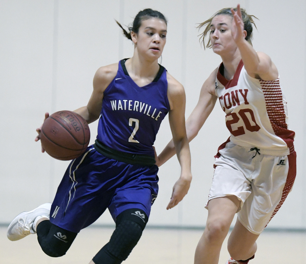 Cony senior MacKenzie Lewis defends Waterville's Paige St. Pierre during a Kennebec Valley Athletic Conference game Tuesday in Augusta.