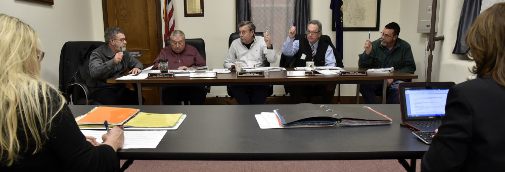 Somerset County Commissioners, from left, Cyp Johnson, Lloyd Trafton, Chairman Newell Graf Jr., Robert Sezak and Dean Cray vote during a meeting in Skowhegan on Wednesday.
