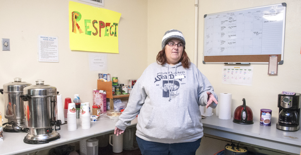 Melanie Scott stands in the coffee area Saturday in the Augusta Community Warming Center in the former St. Mark's Church parish hall on Pleasant Street in Augusta.