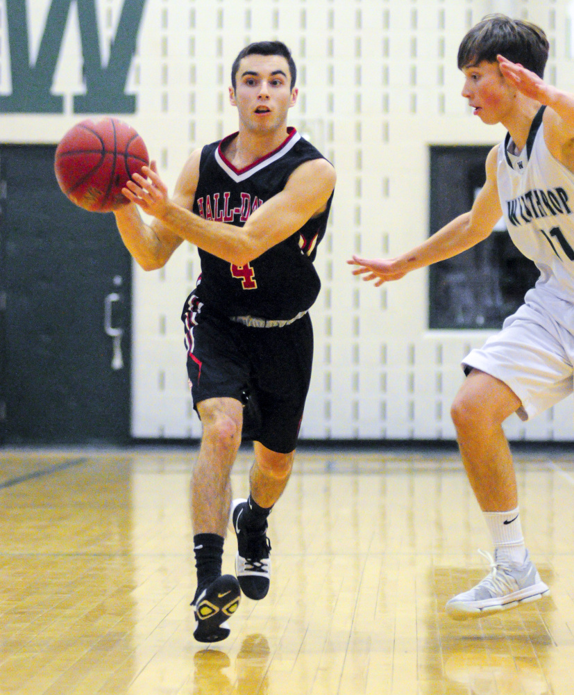 Hall-Dale's Tyler Nadeau, left, looks for a teammate to pass to as Winthrop's Beau Brooks defends during a game Saturday in Winthrop.