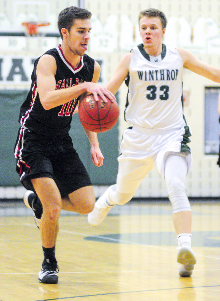 Hall-Dale's Alec Byron, left, dribbles up the court ahead of Winthrop's Nate Leblanc during a game Saturday in Winthrop.